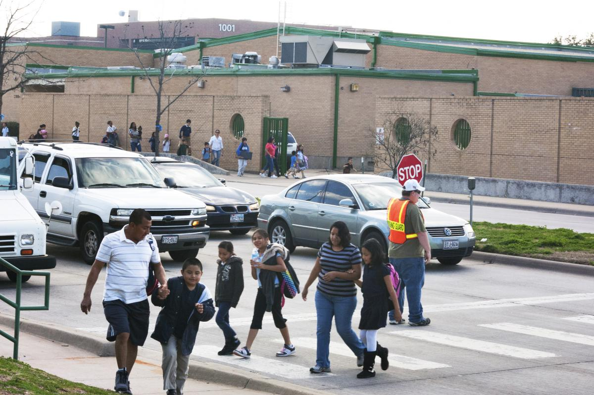 Kids and parents walking from school in Dallas, TX